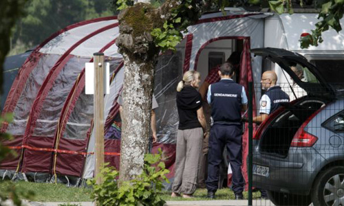 Gendarmes and investigators stand at the camp site where the slain British family were holidaying in Saint Jorioz, near Annecy on Sept. 6, 2012. /AP