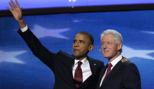 President Barack Obama waves as he joins Former President Bill Clinton during Democratic National Convention on Sept. 5, 2012. /AP