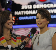 Actress Eva Longoria (right) is interviewed on the floor of the Democratic National Convention in Charlotte, North Carolina on Sept. 6, 2012. /AP