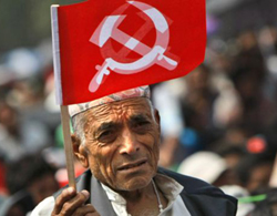 A supporter of Nepal Communist Party Maoist waves a flag during a mass rally in Katmandu, Nepal on June, 15, 2012. /AP