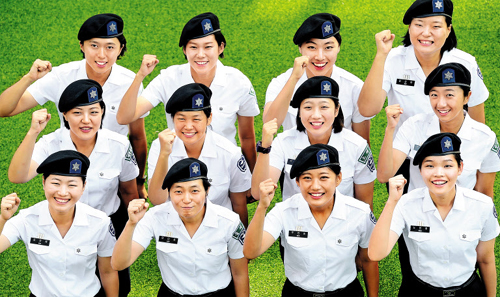 Reserve Officers Training Corps (ROTC) cadets from Sookmyung Womens University pose for a photo at their university campus in Seoul on Thursday.