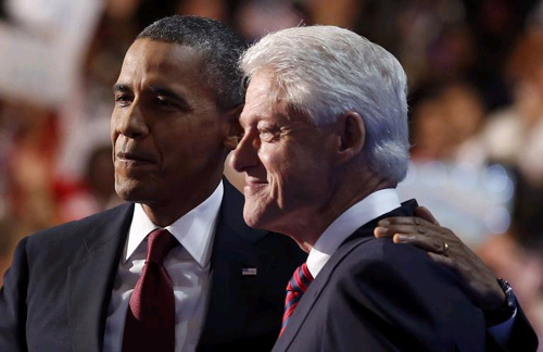 U.S. President Barack Obama (left) embraces former President Bill Clinton onstage after Clinton nominated Obama for re-election during the second session of Democratic National Convention in Charlotte, North Carolina on Sept. 5, 2012. /Reuters