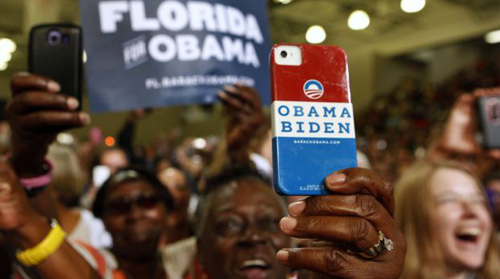 A supporter uses her personalized mobile phone to take a picture of U.S. President Barack Obama as he speaks at a campaign event at the Florida Institute of Technology in Melbourne, Florida on Sept. 9, 2012. /Reuters