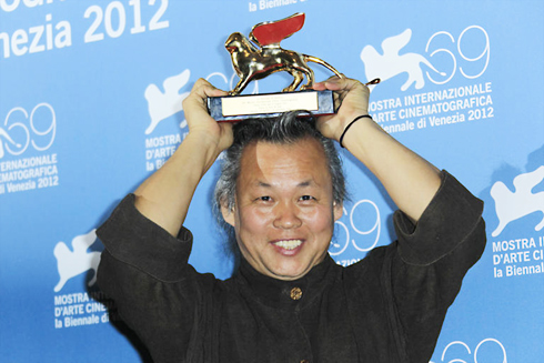 Director Kim Ki-duk poses with the Golden Lion at this years Venice Film Festival on Sunday. /AP-Yonhap