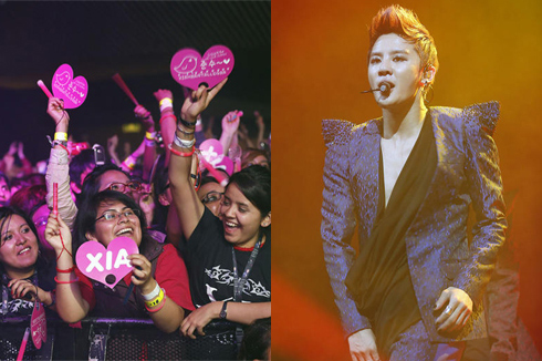 Fans cheer at a solo concert by Kim Jun-su (left), a member of K-pop group JYJ, as he performs on stage in Mexico on Friday. /Courtesy of C-Jes Entertainment