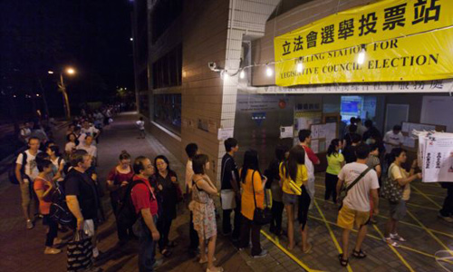 People queue as they wait to cast their votes at a polling station in Hong Kong on Sept. 9, 2012. /Reuters