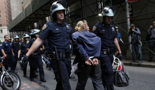 Police officers take away a protester during an Occupy Wall Street march at the New York Stock Exchange in Manhattan on Sept. 17, 2012. /AP