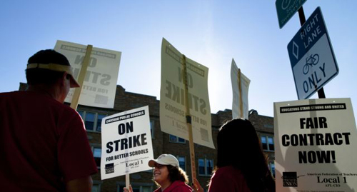 Public school teachers picket outside Amundsen High School in Chicago on the first day of a strike by the Chicago Teachers Union on Sept. 10, 2012. /AP