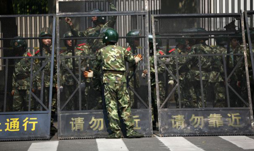 Paramilitary police officers arrange the steel fence at the Japanese Consulate General in Shanghai on Sept. 19, 2012. /AP