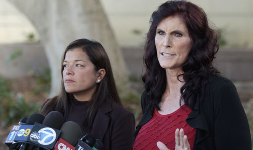 Cindy Lee Garcia (right) and attorney M. Cris Armenta hold a news conference before a hearing at Los Angeles Superior Court in Los Angeles on Sept. 20, 2012. /AP