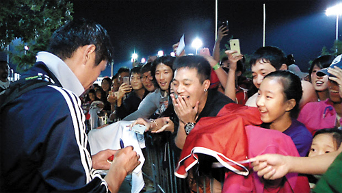 Lee Young-pyo of the Vancouver Whitecaps signs autographs for fans after a Major League Soccer match against FC Dallas on Sunday.