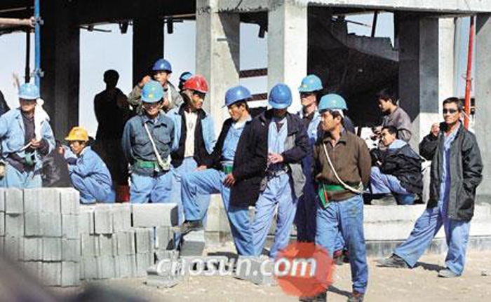 North Korean workers take a rest at a construction site in Mesaieed, 40 km south of Doha, Qatar.