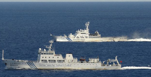 Aerial photo from Kyodo News aircraft show Chinese marine surveillance ship Haijian No. 51 (front) as Japan Coast Guard ship sails near disputed islands, East China Sea on Sept. 15, 2012. /Reuters