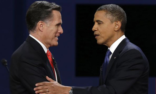 Republican presidential nominee Mitt Romney and President Barack Obama shake hands after the first presidential debate at the University of Denver, in Colorado on Oct. 3, 2012. /AP