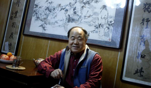 Chinese writer Mo Yan smiles during an interview at his house in Beijing on Dec. 24, 2009. /Reuters