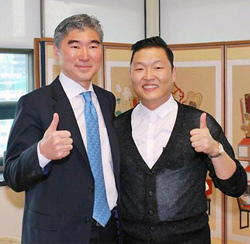U.S. Ambassador to Korea Sung Kim (left) poses with singer Psy in this photo posted on Kims blog. /Yonhap