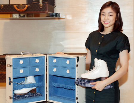 Kim Yu-na poses with the skate case she received from Louis Vuitton on Monday. /Courtesy of Louis Vuitton