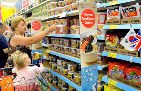 A shopper looks at products at an event to promote Korean food items at a Tesco outlet in London. /Courtesy of Home Plus