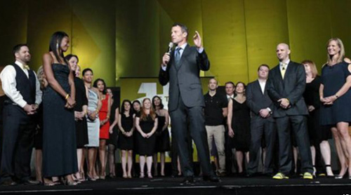 Lance Armstrong stands onstage during the 15th anniversary celebration for Livestrong, his cancer-fighting charity, in Austin, Texas on Oct. 19, 2012. /AP