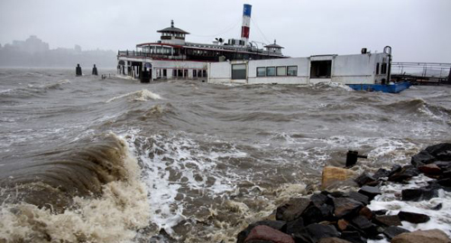 An historic ferry boat named the Binghamton is swamped by the waves on the Hudson River in Edgewater, New Jersey on Oct. 29, 2012 as Hurricane Sandy lashed the East Coast. /AP