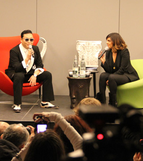 Psy gives an interview in France on Wednesday.