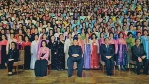 North Korean leader Kim Jong-un (center front) poses with participants to the National Mothers Convention in Pyongyang on Thursday, in this photo released by [North] Korean Central TV. /Yonhap