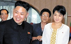 Kim Jong-un (left) with his wife Ri Sol-ju
