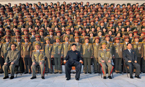 North Korean leader Kim Jong-un pose with intelligence officials, in this photo released by [North] Korean Central TV on Wednesday. /Yonhap