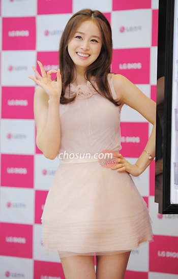 Actress Kim Tae-hee smiles at a promotional event for an electronics company in Seoul on Friday.