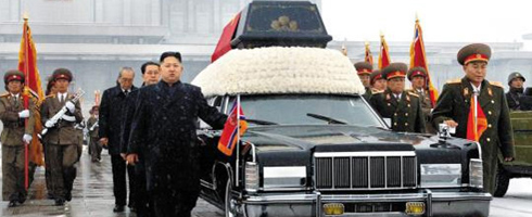 Former North Korean Army chief Ri Yong-ho (right) and Kim Yong-chun, former minister of the Peoples Armed Force, behind Ri, escort the hearse of late North Korean leader Kim Jong-il during his funeral in December 2011. /[North] Korean Central News Agency