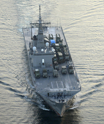 The Japan Maritime Self-Defense Force transport ship Kunisaki, carrying ground-based Patriot Advanced Capability-3 interceptors, leaves the MSDF base in Kure, Hiroshima Prefecture, western Japan. /AP-Newsis