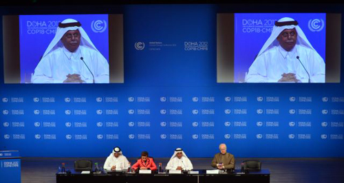 UN Convention on Climate Change Executive Secretary Christiana Figueres, second left, speaks during a press conference alongside Qatars Deputy Prime Minister and president of the 18th United Nations Convention on Climate Change, Abdullah bin Hamad Al-Attiyah, second and on screens in Doha, Qatar on Dec. 3, 2012. /AP
