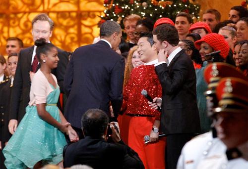 U.S. President Barack Obama greets Korean singer Psy at the end of the