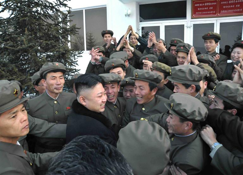 North Korean leader Kim Jong-un celebrates with scientists and technicians after the launch of a rocket, in this picture released by the Norths KCNA news agency in Pyongyang on Wednesday. /Reuters-Yonhap