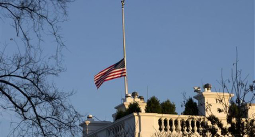 An American flag flies at half-staff in honor of the Connecticut elementary school shooting victims, over the White House in Washington on Dec 14, 2012. /AP