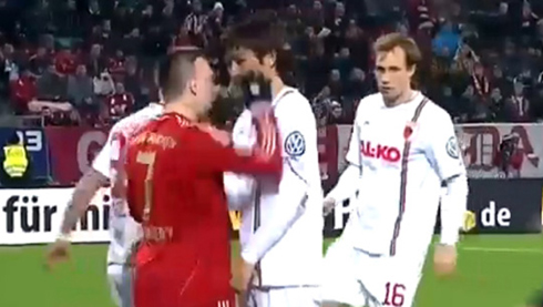 Augsburgs Koo Ja-cheol is shown involved in an altercation with Frank Ribery of Bayern Munich during their DFB-Pokal Cup match in Augsburg on Wednesday. /Sport TV