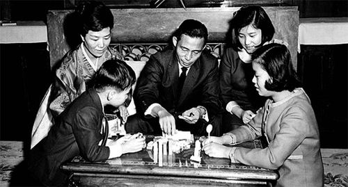 In this undated handout photo, president-elect Park Geun-hye plays with her father and then-president Park Chung-hee and her mother Yuk Young-soo along with her younger brother and sister in Seoul, sometime in the 1960s.