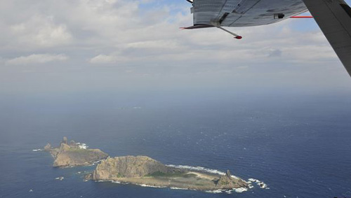 Handout photograph taken on a marine surveillance plane B-3837 shows the disputed islets, known as Senkaku in Japan and Diaoyu in China on Dec. 13, 2012. /Reuters