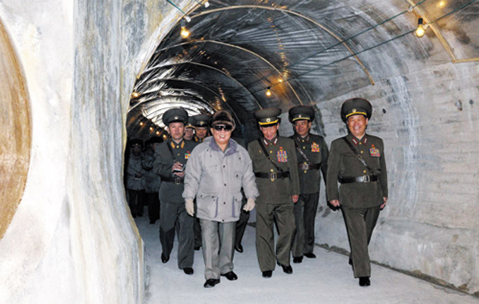 Former North Korean leader Kim Jong-il visits a hydro-electric dam in Huichon, Jagang Province, in this undated photo from the [North] Korean Central News Agency. /KCNA-Yonhap