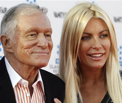 Hugh Hefner and his fiancee, Playboy Playmate Crystal Harris, arrive at the opening night gala of the 2011 TCM Classic Film Festival featuring a screening of a restoration of An American In Paris in Hollywood, California on April 28, 2011. /Reuters