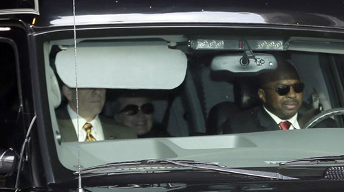 Secretary of State Hillary Clinton (center) is transported on the New York Presbyterian Hospital complex on Jan. 2, 2013. /AP