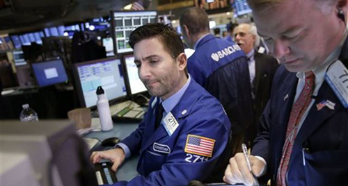 Traders work on the floor at the New York Stock Exchange in New York on Jan. 2, 2013. /AP