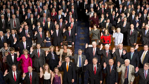Members of the 113th U.S. Congress, many accompanied by family members, take the oath of office in the House of Representatives chamber on Capitol Hill in Washington on Jan. 3, 2013. /AP