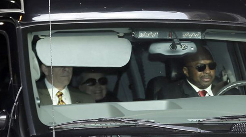 Secretary of State Hillary Clinton (center) is transported from the New York Presbyterian Hospital complex on Jan. 2, 2013. /AP