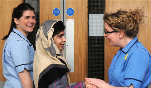 This photo made available by Queen Elizabeth Hospital shows Malala Yousafzai saying goodbye as she is discharged from the hospital to continue her rehabilitation at her familys temporary home, Birmingham, England on Jan. 4, 2013. /AP