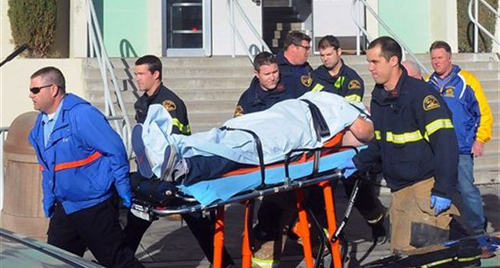 Paramedics transport student wounded during shooting on Jan. 10, 2013 at San Joaquin Valley high school in Taft, California. / AP