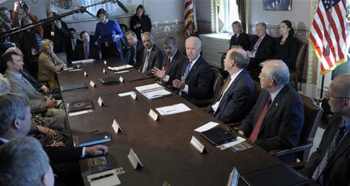 U.S. Vice President Joe Biden, center, meets with sportsmen, wildlife groups, and cabinet members, Washington on Jan. 10, 2013. /AP