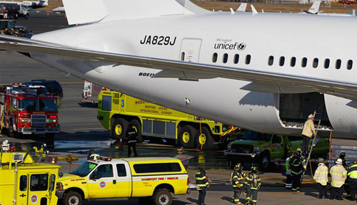Japan Airlines Boeing 787 Dreamliner jet surrounded by emergency vehicles at Logan International Airport in Boston on Jan. 7, 2013. /AP