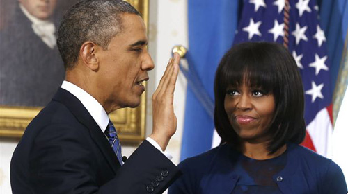 President Barack Obama is officially sworn-in by Chief Justice John Roberts in the Blue Room of the White House on Jan. 20, 2013. /AP 