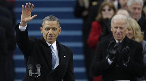 President Barack Obama waves after his speech while Vice President Joe Biden applauds at the ceremonial swearing-in at the U.S. Capitol on Jan. 21, 2013. /AP